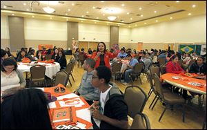 Laura Saavedra, center, admission representative at Bowling Green State University, encourages Latino high school students to consider attending Bowling Green State University.