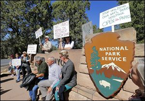 Protesters against the government shutdown gather at the Grand Canyon National Park entrance, which remained closed to visitors because of the partial government shutdown.