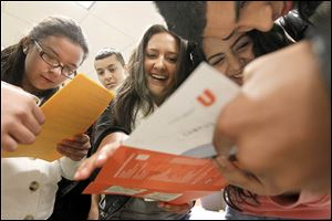 Students from Western International High School in Detroit, from left, Vanessa Varela, 16, David de Luna, 16, Carolina Guiterrez, 16, Analisa Alvarez, 16, and Juan Flores, 16, look over a map of the campus at Bowling Green State University for a scavenger hunt during an event called 'El Encuentro,' or 'The Encounter.' The program is designed to attract Latino high school students to the university.