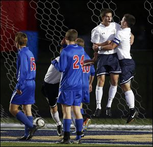 St. John's Jesuit's Cole Myers (8), left, celebrates a goal with teammate Camden Buescher (7) against  rival St. Francis de Sales on Tuesday.