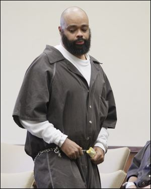 Robert F. Carter, 44, of Toledo is sentenced to 30 years for the aggravated murder of his estranged wife, Wendabi Triplett, 41, who was killed on Christmas Eve in front of her children. Judge Myron Duhart chastised Carter for the 'henious, henious' crime and for not showing any remorse.