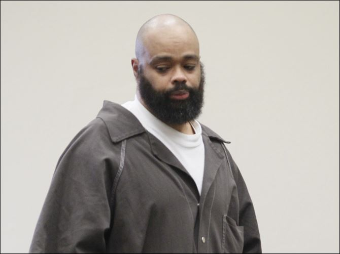 CTY carter07p Robert F. Carter, 44, of Toledo is sentenced to 30 years for the aggravated murder of his estranged wife, Wendabi Triplett, 41, who was killed on Christmas Eve in front of her children. Judge Myron Duhart chastised Carter for the 'henious, henious' crime and for not showing any remorse.