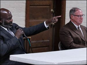 Mayoral candidates Mayor Mike Bell, left, and D. Michael Collins debate during forum at Walbridge Park shelter house.