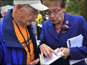 Ohio Congresswoman Marcy Kaptur talked with Honor Flight   member and Navy veteran Dwaine Betz.