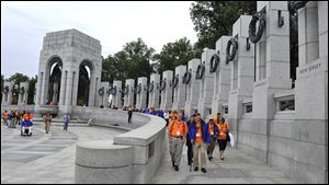 Members of the Honor Flight of Northwest tour the World War II Memorial on Wednesday in Washington. Park service rangers said they are allowing anyone to enter the park for First Amendment activities.