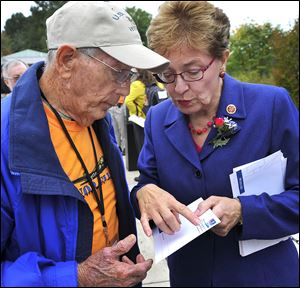 Ohio congressman Marcy Kaptur talked with Honor Flight of Northwest Ohio  member and Navy veteran Dwaine Betz at the World War II Memorial in Washington. Miss Kaptur was instrumental in getting the memorial built.