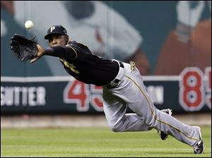 Pittsburgh Pirates left fielder Starling Marte makes a diving catch on a ball hit by St. Louis Cardinals' Matt Carpenter in the third inning.
