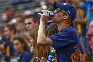UT senior Jonathon Hilvers drinks beer during the Rockets' football game last weekend at the Glass Bowl. This is the first year UT has allowed the sale of alcohol at sporting events.