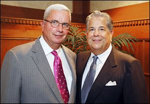 Dennis Johnson, left, and Contributor Award winner Mark Rodriguez at the Press Club of Toledo's annual awards ceremony.