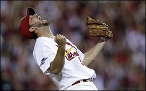 St. Louis Cardinals pitcher Adam Wainwright celebrates after striking out Pittsburgh Pirates' Pedro Alvarez for the final out.