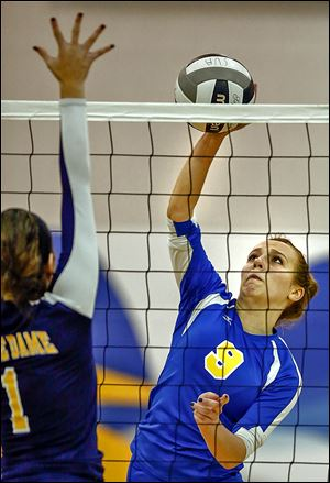 St. Ursula's Emily Lydey spikes the ball against Notre Dame's Alexa Saunders. Lydey finished with five kills in the three-game win.