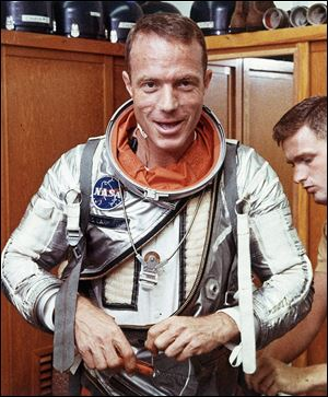 Astronaut Scott Carpenter has his space suit adjusted by a technician in Cape Canaveral, Fla. in this 1962 file photo.