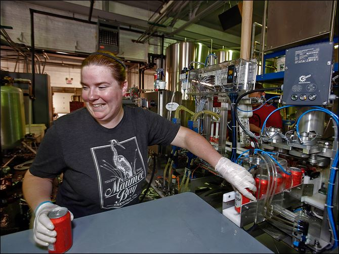 Buckeye beer can Shannon Mohr moves canned Buckeye Beer to be pasteurized at Maumee Bay Brewing Co. The brewery started bottling some of its craft beers earlier this year, and the portable canning line became operational at the beginning of the month.