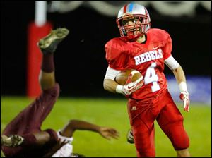 Bowsher's Kolton Davis (4) runs for a touchdown on a punt return against Scott High School during the third quarter.