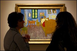 "Women discuss Vincent van Gogh's ""The Bedroom at Arles,"" on display at The Phillips Collection in Washington."