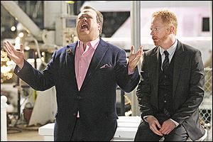 Eric Stonestreet, left, and Jesse Tyler Ferguson play a gay couple in the ABC television series 'Modern Family.'