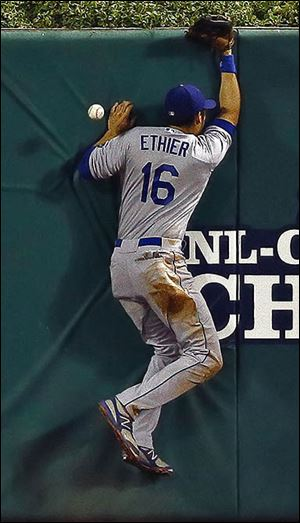 The Dodgers' Andre Ethier can't come up with a double by the Cardinals' Carlos Beltran.