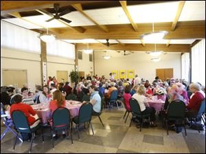 Several dozen women got together for a luncheon to support the Polly Fox Academy on Saturday, Sept. 28, 2013, at the Sylvania United Church of Christ.