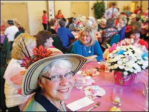 Marge Carter of West Toledo, center, sported a straw hat with flowers.