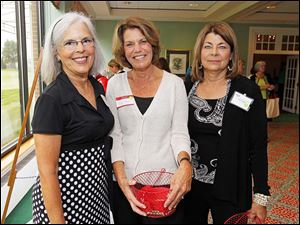Martha Nordstrom, left, Mary Tonjes and Connie Fields, right, at the Christ Child Society 12th annual Red Wagon Show at Inverness Club, Tuesday, October 1, 2013.