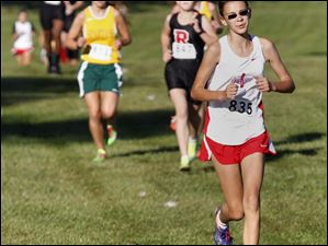 Bowsher's Megan Johnson, front, leads runners in the City League cross country meet.