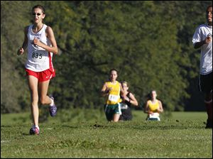 Bowsher's Megan Johnson, left, won the City League cross country meet.