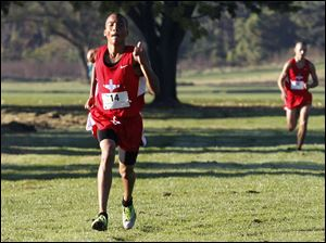 Bowsher's Nate Price, followed by teammate Tom Heckman.