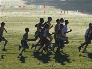 The boys take off in the City League cross country meet.