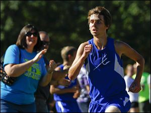 Springfield senior Kohl Taberner runs for the finish line to place first.