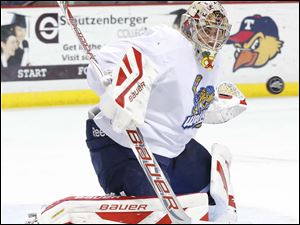 Toledo Walleye goalie Mac Carruth blocks a shot by the Kalamazoo Wings during the second period.