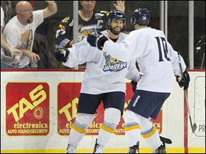 Toledo Walleye players Jason Lepine (24) and David Gilbert (10) celebrate Lepine's goal during the second period.
