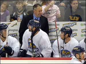 Walleye head coach Nick Vitucci has a light moment with his players as they ready to play the Wings.