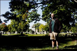 Doug Trueman, chief horticulturalist for the Toledo Division of Parks, Recreation, and Forestry, pictured at Forest Cemetery in Toledo, has been working on creating a searchable database of about 65,000 records. Some listings on the Cemeteries Record Tracker are from before 1867.