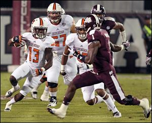Bowling Green running back Travis Greene evades Mississippi State defensive back Nickoe Whitley during the first half Saturday night in Starkville, Miss.
