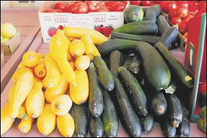 David Johnson's home grown zucchini and yellow squash on sale at the market.