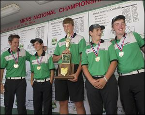 Ottawa Hills accepts their Division III championship trophy. From left is Ben Silverman, Michael Denner, R.J. Coil, with trophy, Matt Abendroth, and Ben Dayton.