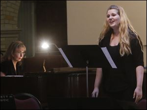 Olga Topuzova-Meade, left, played the piano for her student, soprano Courtney Gilliland.