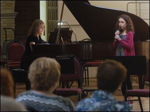 Olga Topuzova-Meade, left, played the piano as her daughter Sasha, 10, sang.