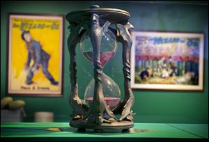 The hourglass from the movie 'The Wizard of Oz' is displayed at the Farnsworth Art Museum in Rockland, Maine, as part of a 107-piece exhibit of props from movies, early books, posters, and an array of memorabilia from the pop culture sensation.