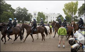 U.S. Park Police move past the front of the White House on Pennsylvania Avenue on  Sunday, where war veterans and Tea Party groups were protesting the partial government shutdown now entering its third week.