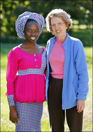 Esther Ibrahim, 15, a Nigerian exchange student at Bedford High School, pauses with her host 'mom,' Teresa Arnold of Lambertville.