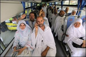 Egyptian pilgrims chant as they ride a bus from Mecca to Arafat, in the Muslim holy city of Mecca on Sunday. The hajj, a central pillar of Islam and one that able-bodied Muslims must make once in their lives, is a four-day spiritual cleansing based on centuries of interpretation of the traditions of Prophet Mohammad.