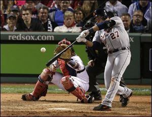 Detroit's Jhonny Peralta hits a double in front of Red Sox catcher David Ross during the eighth inning of Game 1 in theAL championship series Saturday in Boston.