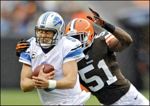 Detroit Lions quarterback Matthew Stafford is chased by Browns linebacker Barkevious Mingo in the second quarter Sunday in Cleveland. Stafford threw four touchdown passes in Detroit's win.