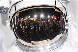 The 'Gravity' premiere red carpet as seen from a reflection in an astronaut's helmet at the AMC Lincoln Square Theaters in New York. The Warner Bros. astronaut adventure directed by Alfonso Cuaron and starring Sandra Bullock and George Clooney landed in the top spot at the box office for the second weekend in a row, according to studio estimates Sunday.
