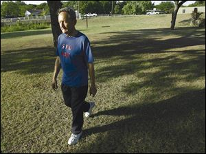 Kenyon Albrecht, 73, has osteoporosis, a disease common in elderly women. As part of his treatment he uses resistance training and walks.