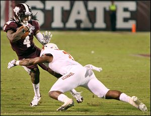 Mississippi State wide receiver Jameon Lewis, left, tries to dodge Bowling Green defensive back Brian Sutton in the second half on Saturday. Lewis finished with 34 receiving yards for the Bulldogs.