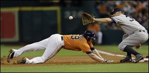 Marc Krauss dives safely back to first base. The Patrick Henry grad played in 52 games for Houston this season.