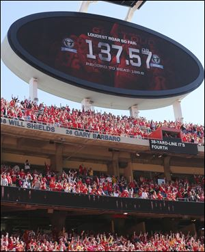 Chiefs fans cheer while setting a world record as the loudest stadium crowd during the second half of a game against the Oakland Raiders on Sunday at Arrowhead Stadium in Kansas City. Guinness World Records officials were present to confirm the record. The Chiefs won 24-7.