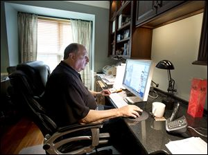 Graphic designer Tom Sadowski, 65, who delayed his retirement, works from home in Sterling, Va. Older Americans appear to have accepted the reality of a retirement that comes later in life and no longer represents a complete exit from the work force, a survey finds.